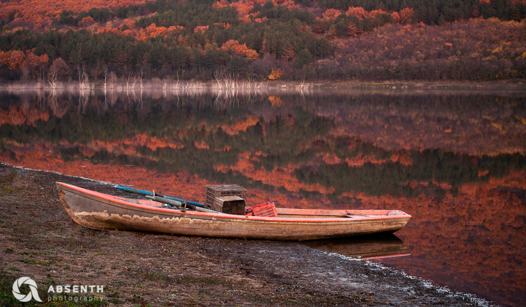 Boat On An Autumn Lake Shore